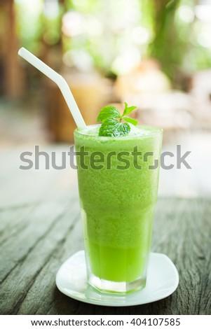 glass of green tea smoothie - stock photo