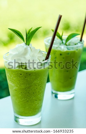 Glass of green tea smoothies with fresh green tea