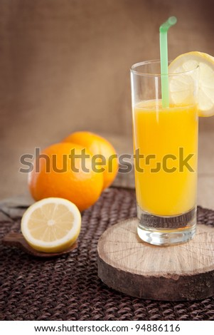 Glass of healthy orange and lemon juice drink