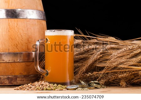 Glass of home made beer on table  - stock photo