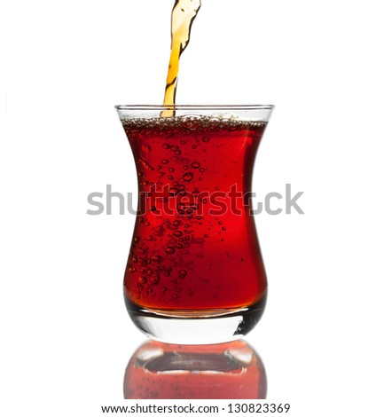 Glass of hot black Turkish tea isolated on white background