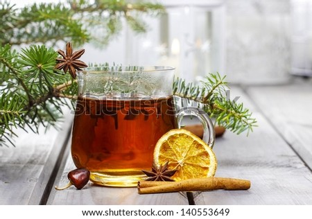 Glass of hot tea on wooden background. Copy space. - stock photo