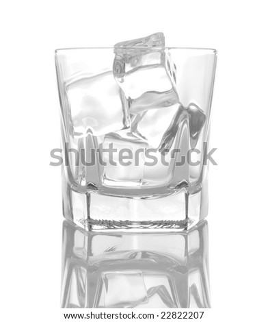 Glass of ice cubes isiolated on white background with reflections - stock photo