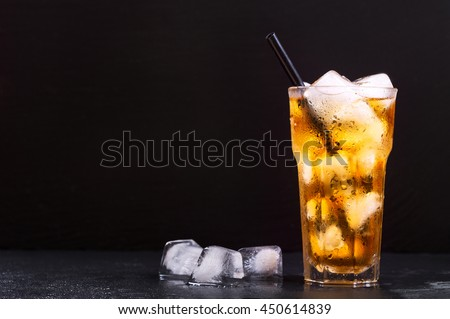 glass of iced tea on dark background - stock photo