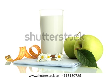 Glass of kefir, green apples and measuring tape isolated on white - stock photo