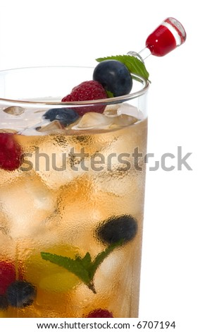 Glass of Kew Punch cocktail - vodka, sweet vermouth, gin, cherry brandy, orange curacao and assorted summer fruits with ginger ale and sparkling lemonade - stock photo