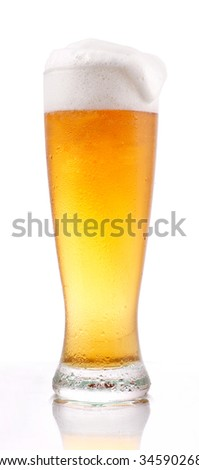 Glass of lager beer on white