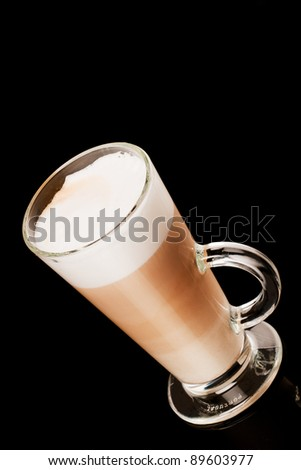 glass of latte over black background - stock photo