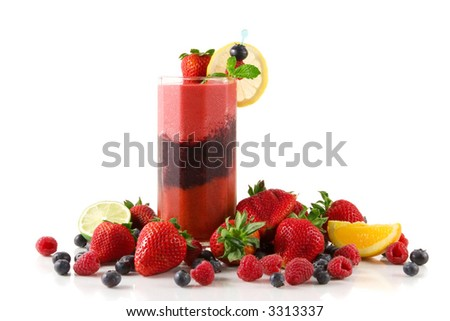 Glass of layered berry smoothie  surrounded by fresh fruits (strawberry,blueberry,raspberry) - stock photo