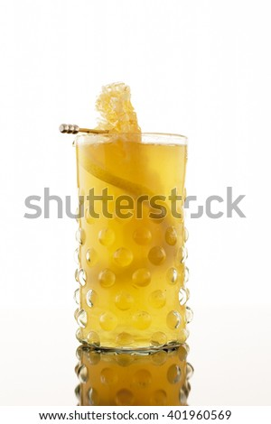 Glass of lemon cocktail isolated on white background