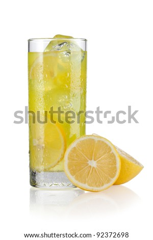 Glass of lemonade with slices of lemon on the side - stock photo