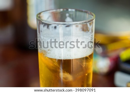 Glass of light beer - stock photo