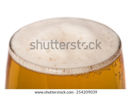Glass of light beer close up isolated on white - stock photo