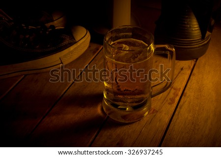 Glass of light beer on a dark