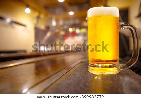 Glass of light beer on a restaurant