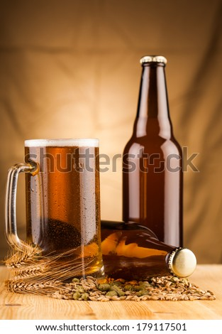 Glass of light beer on table  - stock photo