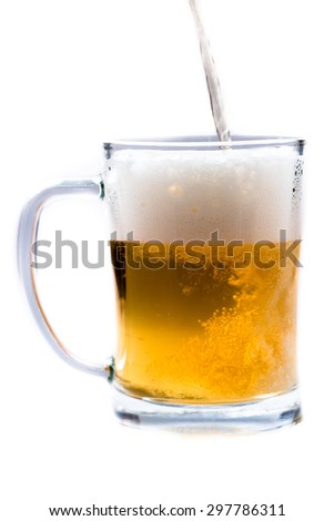 glass of light beer pouring from bottle on a white background - stock photo