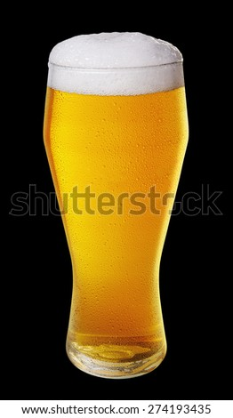 Glass of light beer with drops on a black background