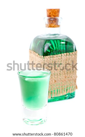 glass of  liqueur / mint drink and bottle - stock photo