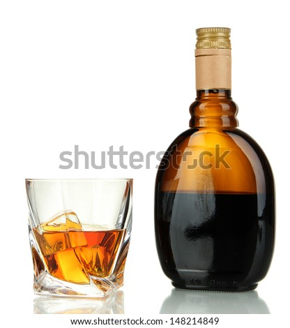 Glass of liquor with bottle, isolated on white - stock photo