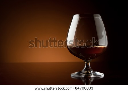Glass of luxury cognac with copy space - stock photo