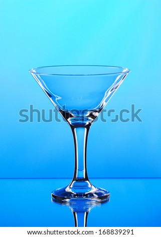 glass of martini on blue background