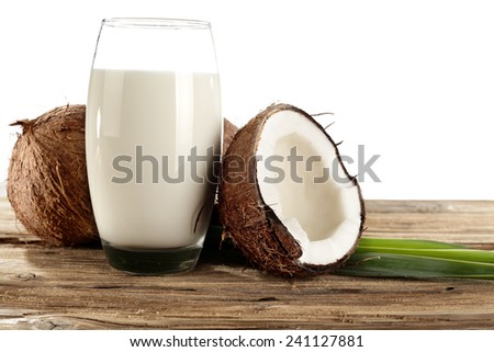 glass of milk and coconuts  - stock photo