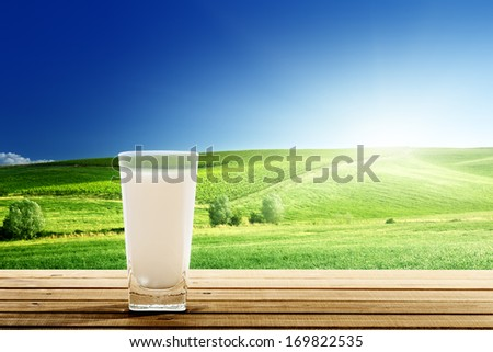 glass of milk and sunny day - stock photo