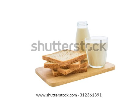 glass of milk and whole wheat bread on white background with clipping path - stock photo