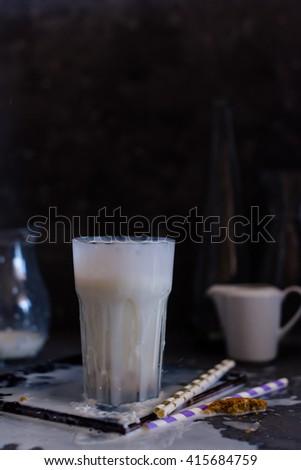 glass of milk in dark - stock photo
