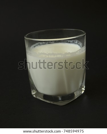 glass of milk on black background