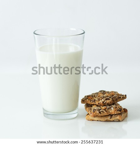 Glass of milk on the table - stock photo