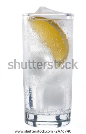 Glass of mineral water with lemon - stock photo