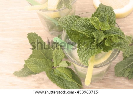 Glass of mint lemonade. Toned image - stock photo