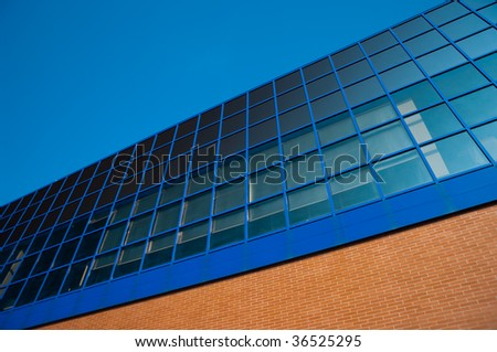 glass of modern building and brick wall