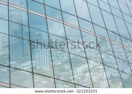 Glass of modern tower, city reflection beautiful. - stock photo