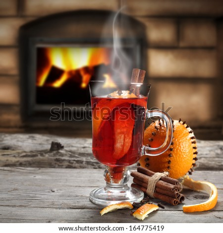 glass of mulled and fire  - stock photo