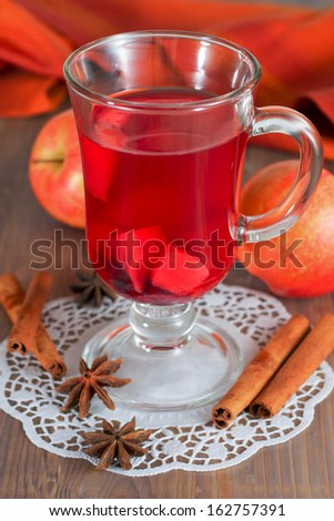 Glass of mulled wine, anise, cinnamon, apples