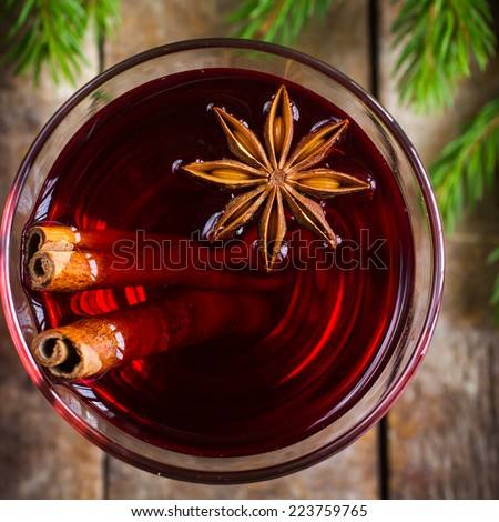 Glass of mulled wine with cinnamon and anise, top view,  square image - stock photo