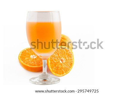 glass of orange juice and some orange fruit with right space for adding some text - stock photo