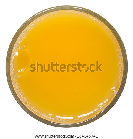 Glass of orange juice from above