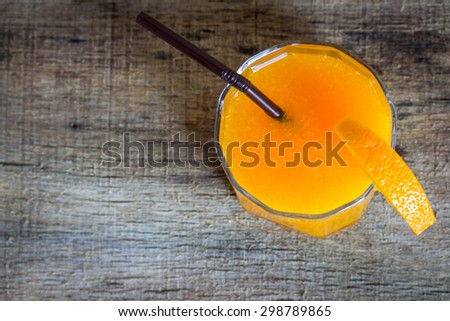 glass of orange juice on wooden background - stock photo