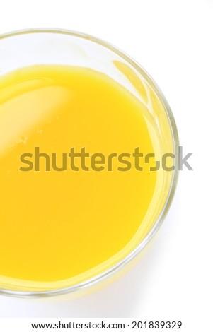 glass of orange juice overhead isolated on white background - stock photo