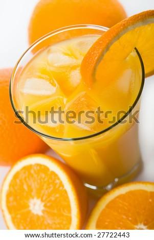 glass of orange juice with ice cubes - stock photo