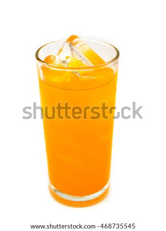 glass of orange soda with ice on white background