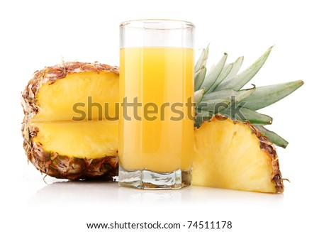 Glass of pineapple juice with fruit and slices isolated on white - stock photo