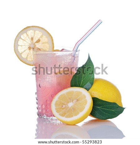 Glass of pink lemonade and lemons with leaves - stock photo