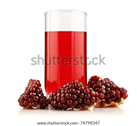 Glass of  pomegranate juice with sliced fruits isolated on white background - stock photo