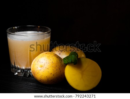 glass of potato juice on dark wooden background with copy space.