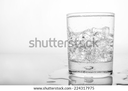 Glass of pure water with ice cubes. - stock photo